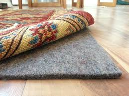 what size pad under area rug medium size of with rug pads for hardwood floors best