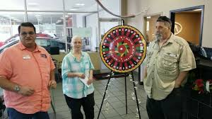 Stephen and Kathleen Fields Spinning the Prize wheel to win a trip to Cuba!  - YouTube