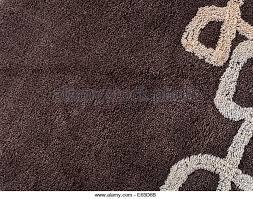 brown carpet texture. close up of brown carpet texture - stock image
