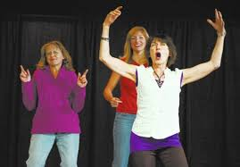 Members of the Las Vegas Improvisation Players, from left, Kim Caris, Amy  Seddon Ebert, and Karla Huntsman, create an on spot scene, during a  workshop held at the American Heritage Academy in