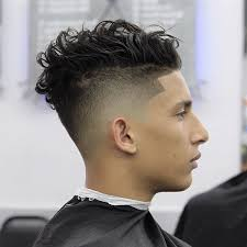 nellynelthebarber loose messy curly hair and high fade haircut by nelly