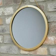 round gold mirror hanging metal chain
