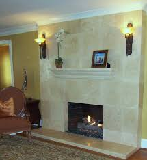 this homeowner preferred to reface their brick fireplace we installed limestone tiles from floor to ceiling to make the 8 ceilings feel taller