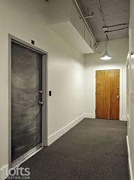 loft door. the steel door entrance to unit from 2nd floor common area hallway. loft s