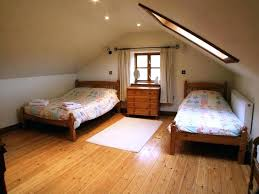 attic bedrooms with slanted walls low ceiling attic conversion how to decorate room with slanted walls