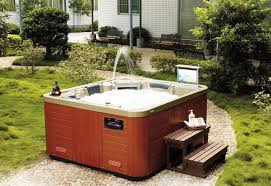 image of outdoor bathtub wood fired