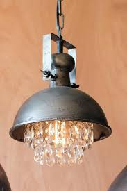 artesano s metal pendant light with hanging crystals