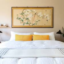 a bed made with linen sheets the strategist reviews the best linen bedsheets