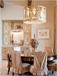 dusty rose neutral dining room with barrel chandelier via kfg interiors and julie neill designs