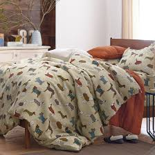 this adorable dog themed flannel duvet cover is covered in a playful pack of dachshunds terriers poodles dalmatianore the company