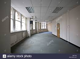 office tiles. Empty, Abandoned Office With Ceiling Tiles And A Grey Carpet