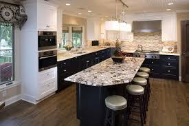 oval shaped backsplash exodus white granite countertop black island white cabinet black cabinet white pendant lights
