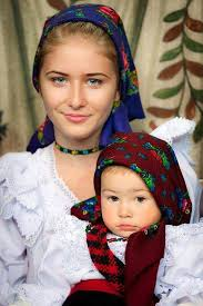 romanian people. proud romanian mother and daughter in their traditional outfits people