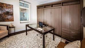 home office murphy bed. murphy style wall bed folds away and room becomes a home office