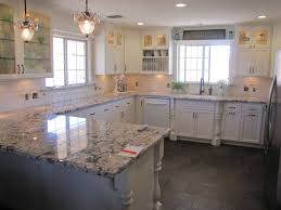 Slate Floors In Kitchen Blanco Antico Granite With White Cabinets And Slate Floors