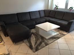 Wohnlandschaft Couch Bett Tisch Teppich