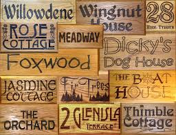 solid oak house signs designed and engraved to your specification we use the finest oak and maple for these signs at one inch thick the signs should