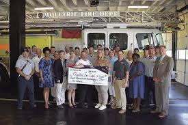 WoodmenLife donation pays for firefighters' helmets | Local News |  moultrieobserver.com
