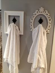Perfect look for hanging towels etc., used old frames/spray paint.