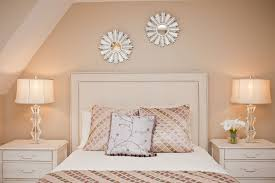ethan allen reno with modern bedroom and beige nail head detail nightstand pillows starburst mirror table lamps upholstered headboard vaulted ceiling white