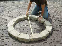 guy measuring firepit