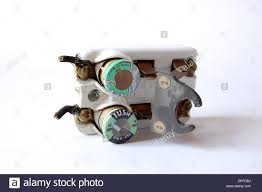 1950s vintage ceramic fuse box electrical circuit breaker with fuses Blown Fuse Circuit Breaker Box 1950s vintage ceramic fuse box electrical circuit breaker with fuses and knife switch plain background natural light closeup