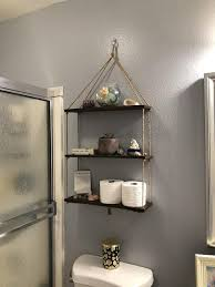 37 clever over the toilet storage ideas
