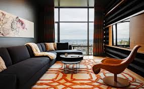 big furniture small living room. In A Room With Dark Walls And Furniture, Add Large Rug Or Carpet That Features Light Colors. This One Cheery Orange Accents Simple But Big Furniture Small Living