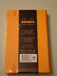 review us rhodia webnotebook paper pen paraphernalia reviews it comes black or orange covers an elastic band a ribbon bookmark and a back pocket the small version measures 3 5 x 5 5 and is lined 6mm