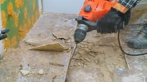 remove tile from concrete floor