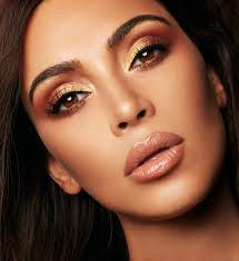 kim kardashian west modeling the warm metallic eye shadows from the kkw x mario collaboration collection