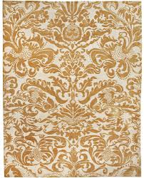 a gold and ivory rug carpet available through david e adler inc