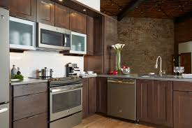 Norcraft Kitchen Cabinets Stainless Steel Appliances Meet Aluminum Cabinet Doors For A Chic