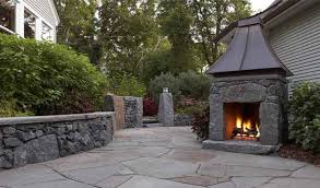 free standing patio deck outdoor stone fireplace