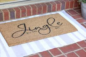 diy rug using a drop cloth and chalk paint and layering a door mat ontop