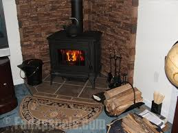 a corner wood burning stove accented with faux stacked stone panels in sierra brown