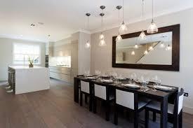 long rectangular mirror above dining table