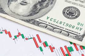 Us Dollar Banknote On The Candlestick Stock Chart