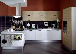 black and white kitchen design pictures. kitchen accent wall design in deep red color, white cabinets and black tiles pictures r