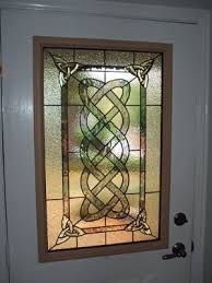 custom traditional stained glass door panel in a celtic design