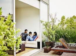 family looking out onto their plant adorned patio