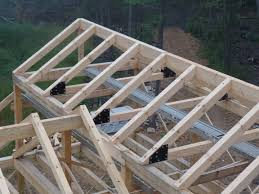 heavy timber roof system with gusset plates post and beam home design under construction