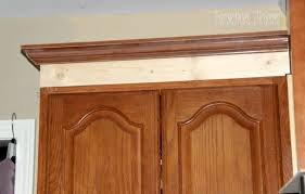 adding height to your kitchen cabinets with simple molding