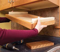 Install the completed drawer assembly. Clamp it to the cabinet and fasten  it with screws from above.