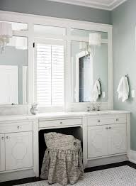 counter height vanity chair. white bathroom cabinets vanity with calcutta gold marble counter tops, acrylic lucite sconces, floor and french script chair. height chair
