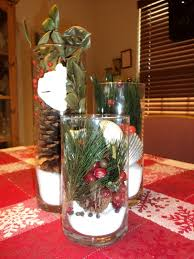red christmas table decorations. Mesmerizing Christmas Table Decorations With Red And White Snow Flake Themes Tablecloth Under Three Glass Vase Which Has Berry Plus Pine Leaves