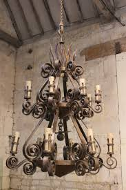 a spectacular 1950s spanish wrought iron chandelier