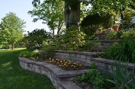 multi tiered stone walls with garden at each level