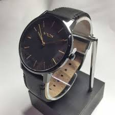 it is a point up nixon nixon watch the porter leather all black gold men watch