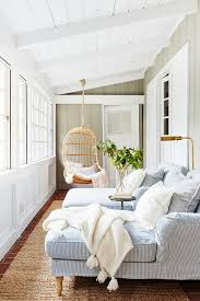 sun room wicker swing basket chair pale blue chaise longue chairs cream throw jute rug white panelling